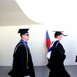 Brigham Young University's Class of 2015 walks into the Marriott Center for its commencement exercises in Provo on Thursday, Aug. 13, 2015.