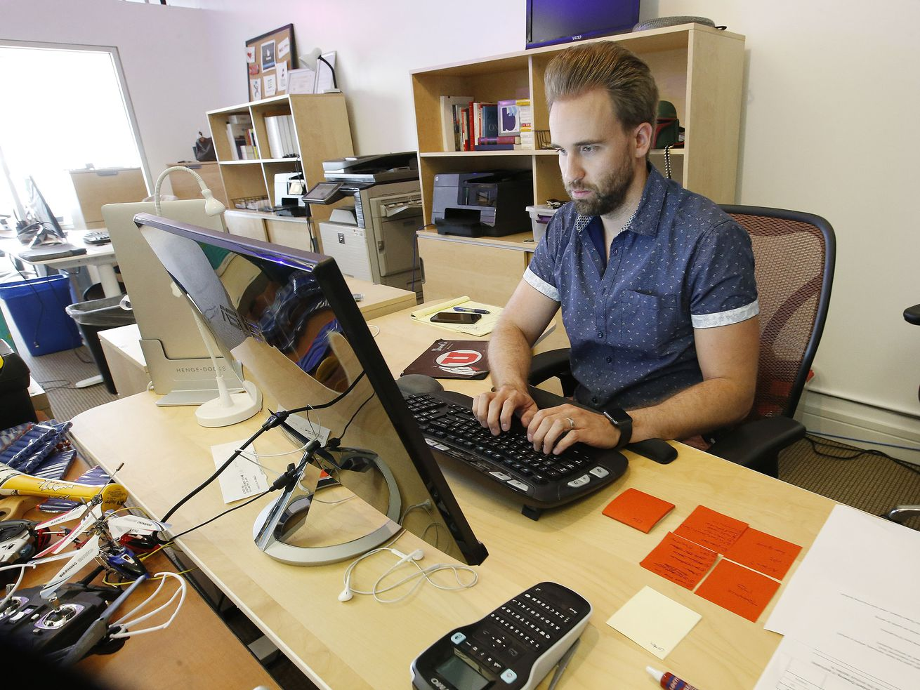 Blyncsy engineer Dallin Starr works at the company's office in Salt Lake City in this July 14, 2017, file photo. Blyncsy has developed anonymized tracking of cellphones combined with data crunching to help solve transportation and movement dilemmas.