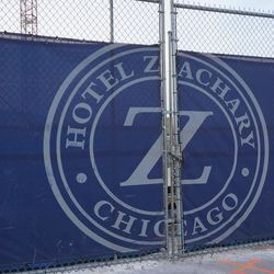 Hotel Zachary logo on the construction gate, at Clark and Addison