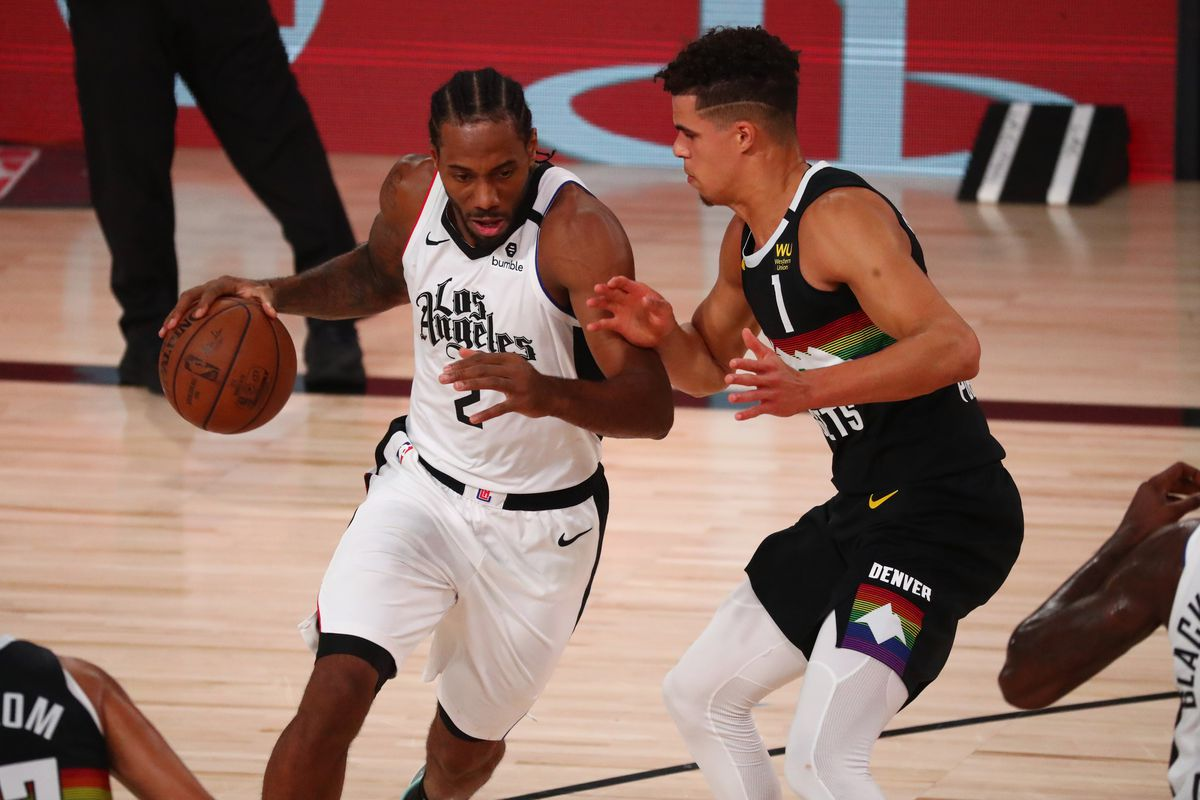 LA Clippers forward Kawhi Leonard drives against Denver Nuggets forward Michael Porter Jr. in the first half in game four of the second round of the 2020 NBA Playoffs at AdventHealth Arena.