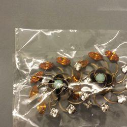clip on earrings, $100