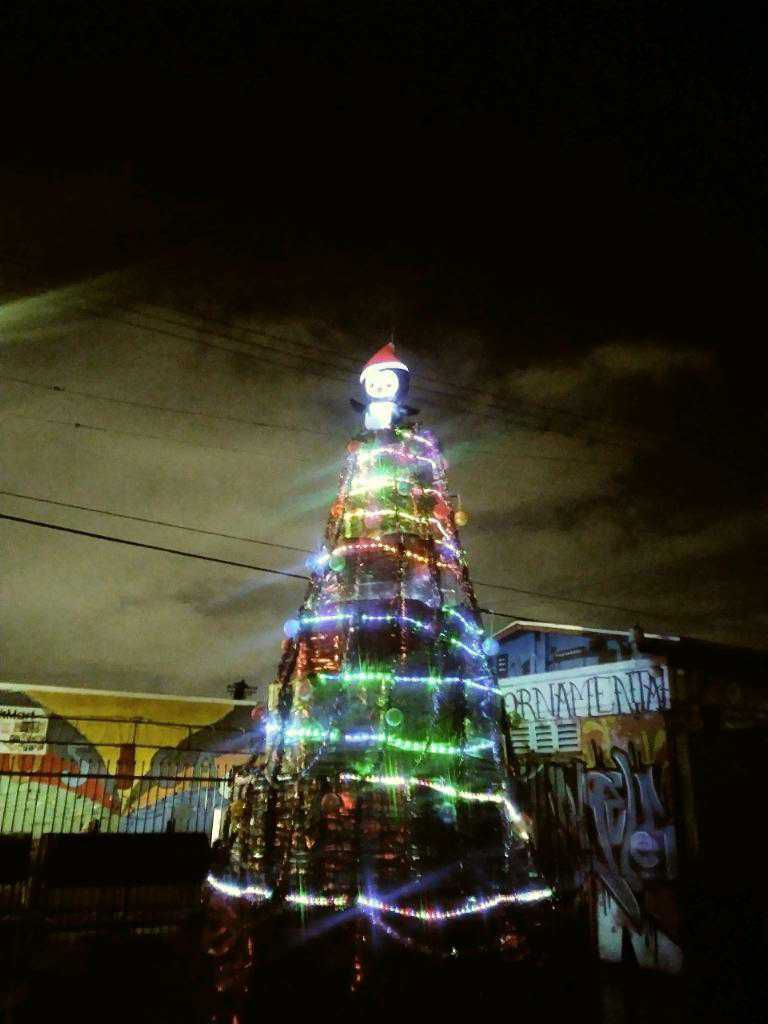 An oil barrel Christmas tree at J & G Ornamental Irons & BBQ Pit Factory in South Los Angeles