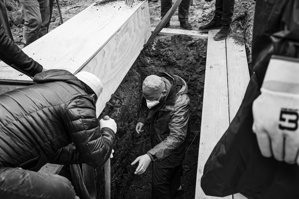 Imam Ahmed Ali jumped into a grave to finish digging it in preparation for the casket of William Johnson.