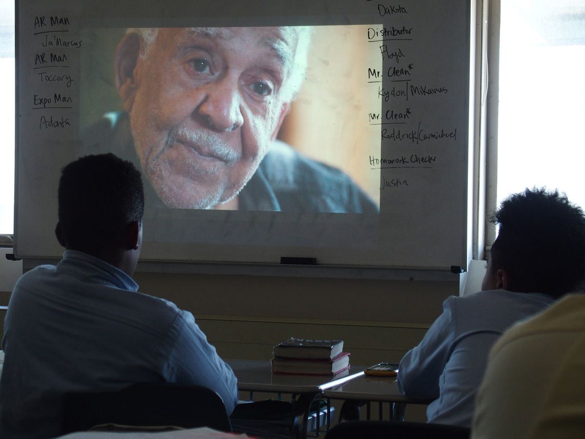 """Students watch as Charlie Morris, the brother of lynching victim Jesse Lee Bond, explains the racism that led to his brother's murder in an episode of """"America Divided."""""""