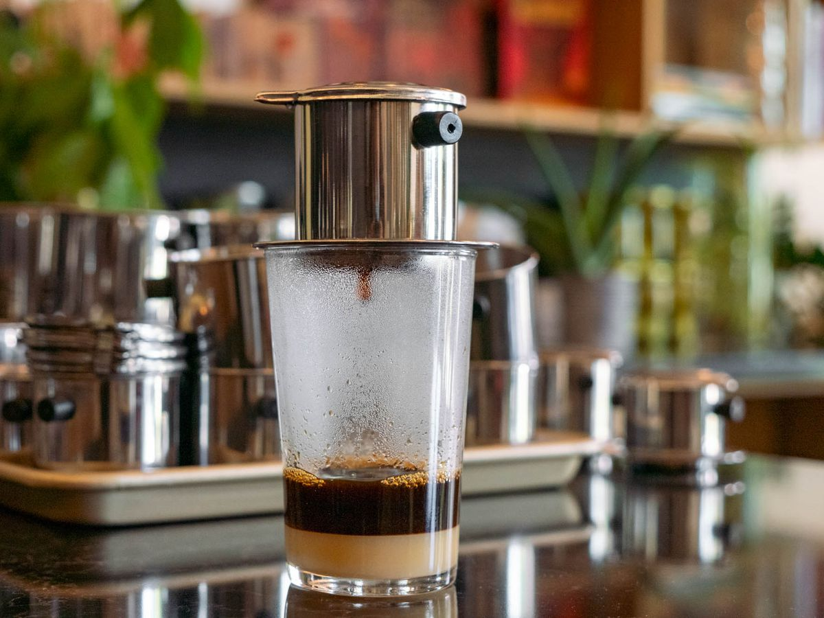 A photo of a phin, brewing coffee at Phin coffee shop in Seattle
