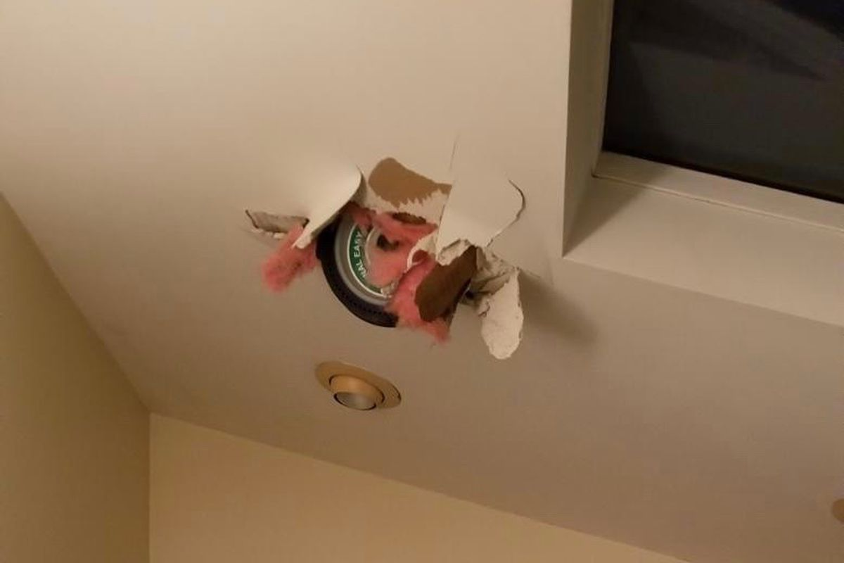 A helicopter wheel hangs from the bathroom ceiling Saturday after crashing into a south suburban Lynwood.