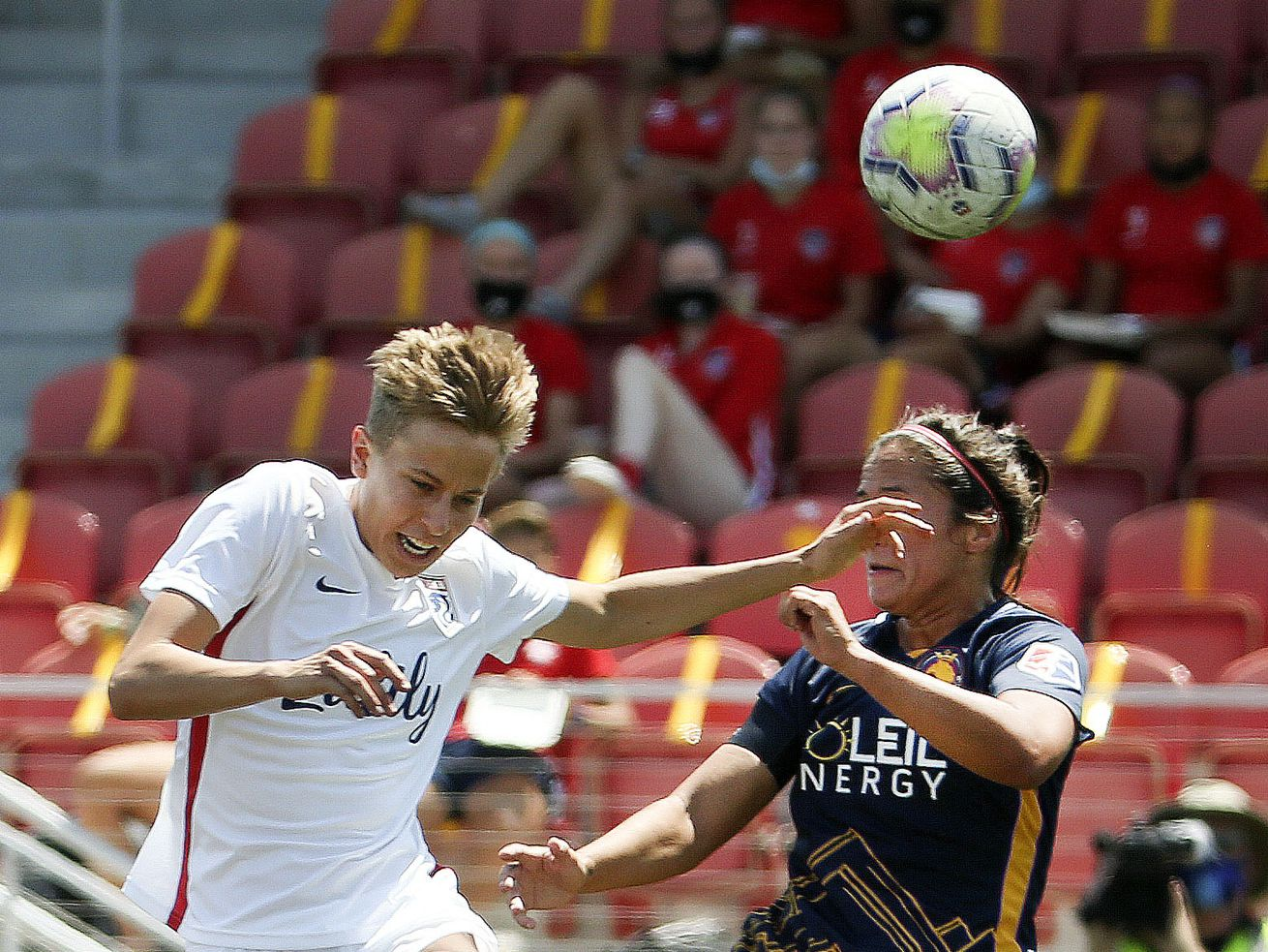 OL Reign player Rebecca Quinn (5) and the Utah Royals' Taylor Leach (24) compete for the ball in a 2020 NWSL Challenge Cup game at Zions Bank Stadium in Herriman on Wednesday, July 8, 2020.