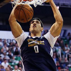Enes Kanter dunks the ball during the Utah Jazz's scrimmage in Salt Lake City, Saturday, Oct. 5, 2013.