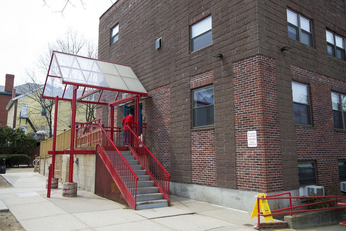 A resident walks into the Casa Esperanza's men's program in Boston's Roxbury neighborhood.   Jesse Costa/WBUR/Kaiser Health News
