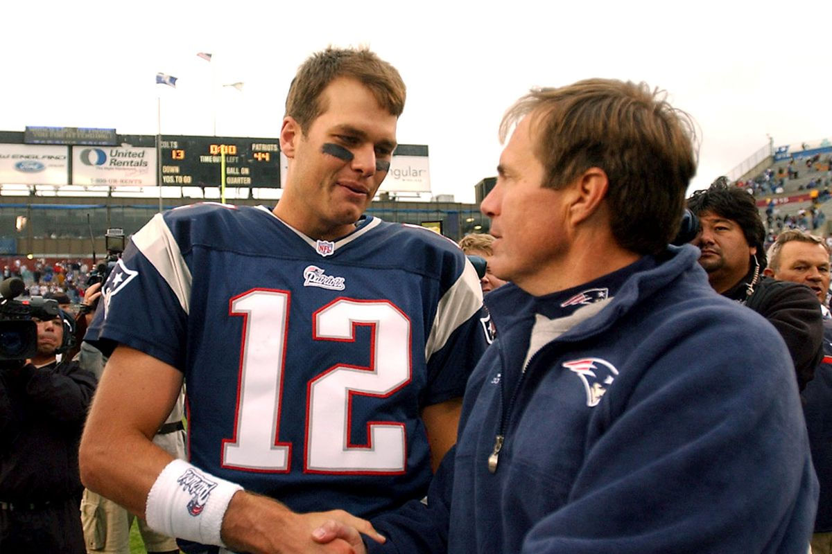 (093001 - Foxboro,MA) PATS v COLTS-Tom Brady accepts the congratulations of Bill Belicheck after the huge upset win over the Colts.-(093001pats- Staff photo by Jim Mahoney and saved in Monday)
