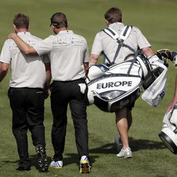 Europe's Luke Donald, left, and Sergio Garcia make their way down the seventh fairway during a practice round at the Ryder Cup PGA golf tournament Wednesday, Sept. 26, 2012, at the Medinah Country Club in Medinah, Ill.