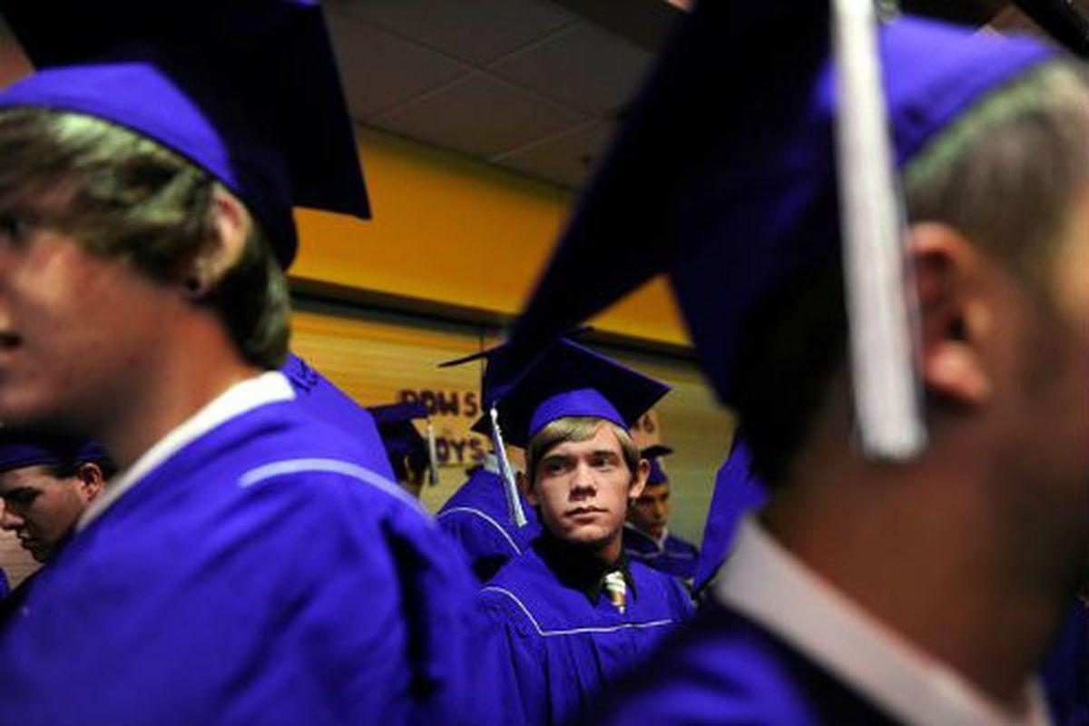 Arvada West High School seniors prepare for graduation in 2013 ( (Seth McConnell, Denver Post ).