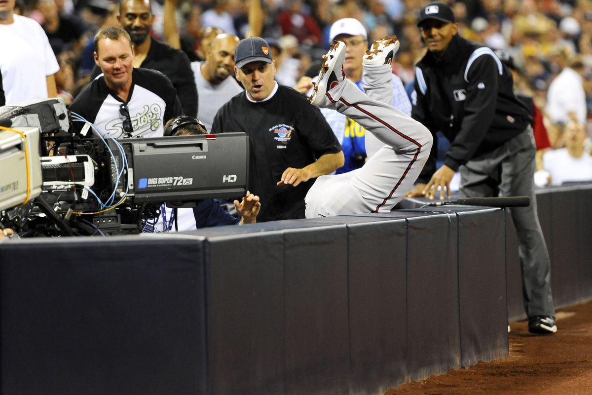 Martin Prado checks to see if his batting average is in the TV well.