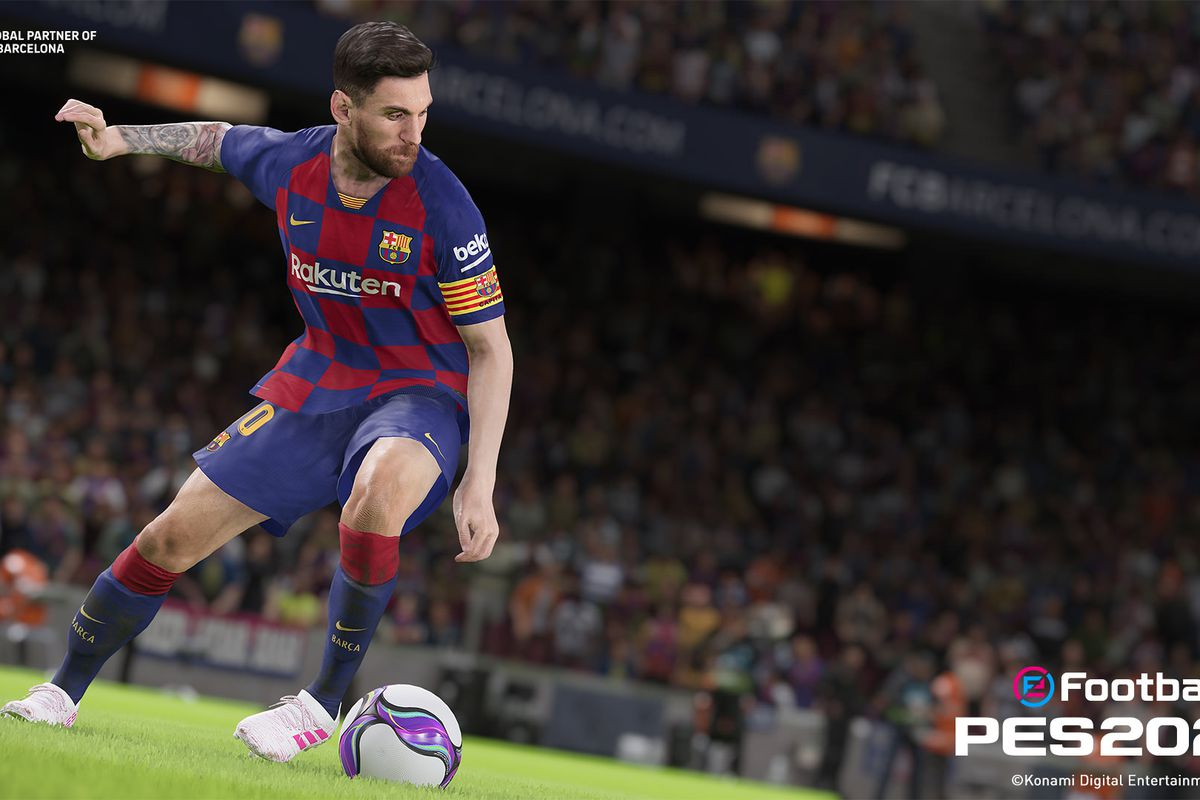 Lionel Messi dribbles a soccer ball in Barcelona's home uniform
