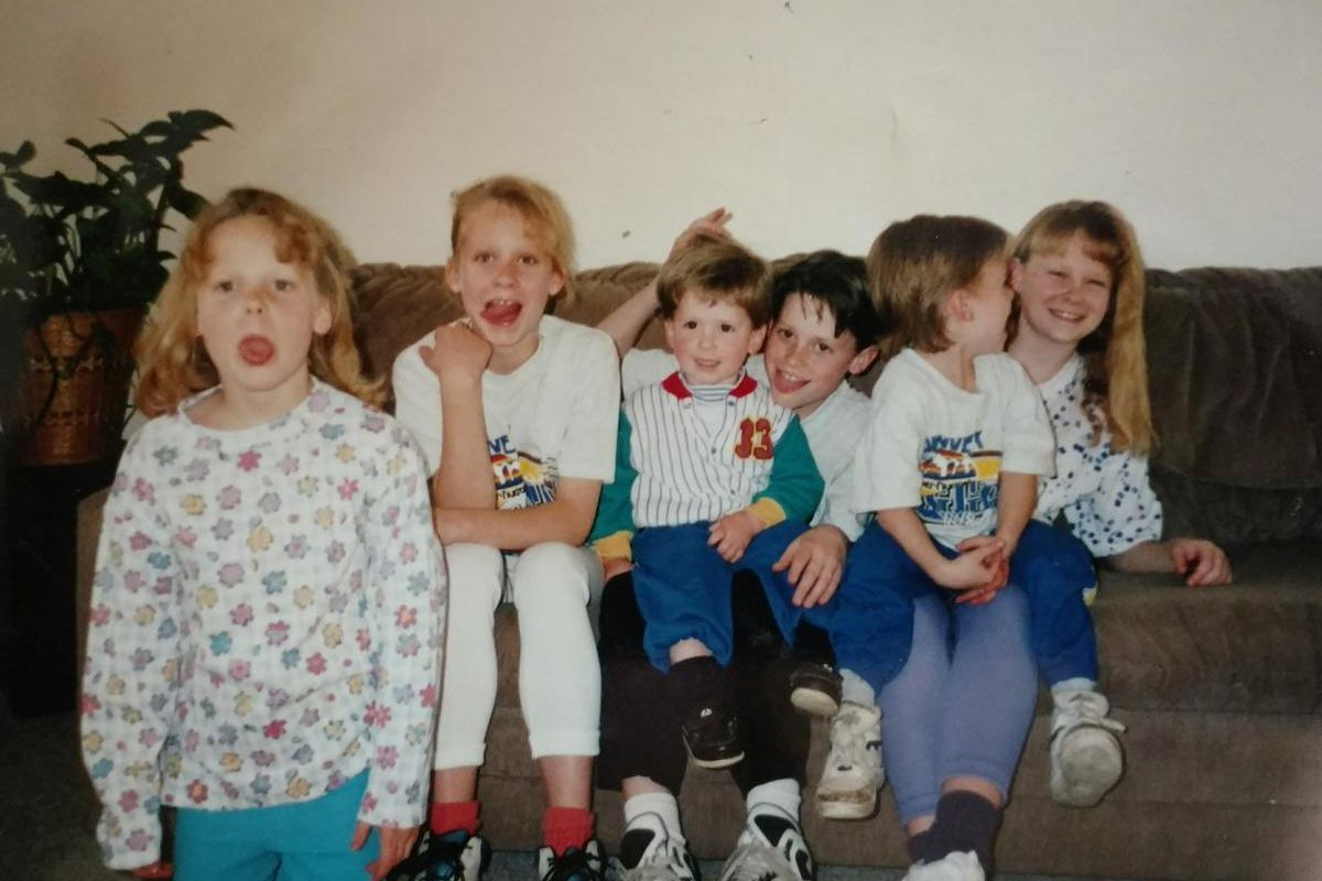 Arianne Brown, second from left, sits with five of her nine siblings in this 1992 photo. Her younger brother Rand is sitting on their oldest sister Megan's lap
