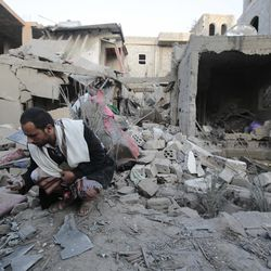 A man holds debris from the rubble of houses destroyed by Saudi-led airstrikes in Sanaa, Yemen, Friday, Jun. 9, 2017. Three siblings and their grandmother were killed early Friday after Saudi-led coalition forces dropped munitions on three houses in the Yemeni capital, the children's father said.