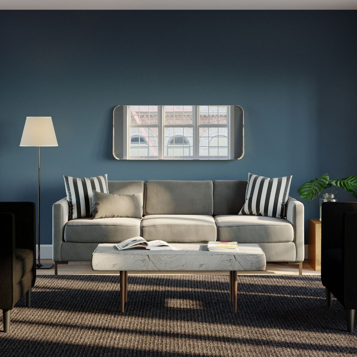Beige sofa in a room with blue walls, and horizontal mirror.