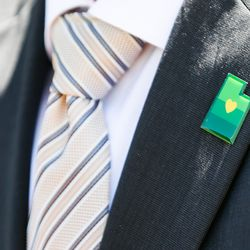 Lt. Gov. Spencer, GOP for governor, wears a campaign logo pin on his lapel during a press conference outside of the Capitol in Salt Lake City on Tuesday, July 7, 2020. On Monday, Cox and his running mate, state Sen. Deidre Henderson, R-Spanish Fork, were declared the winners in the GOP gubernatorial primary.