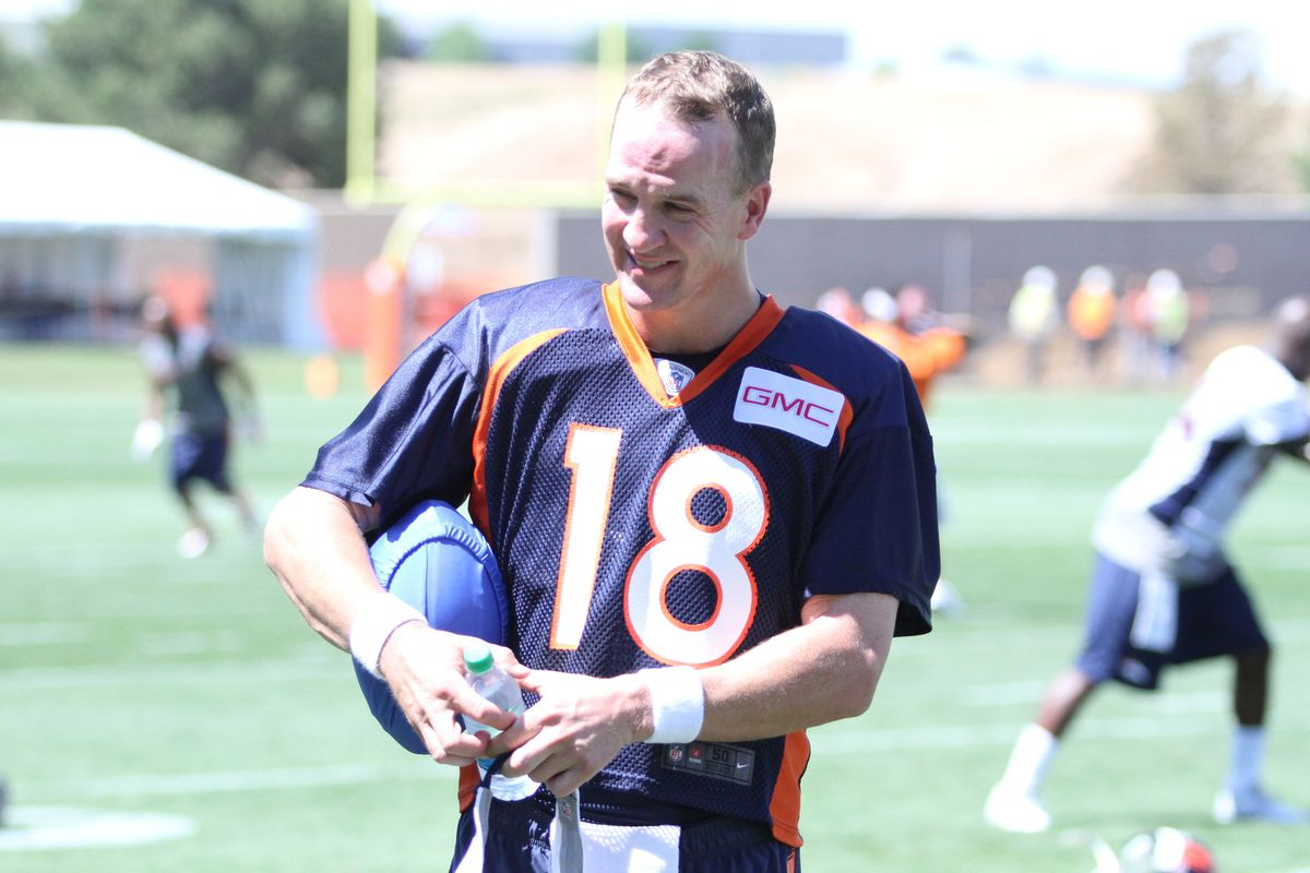 Peyton Manning holding an infamous blue football.