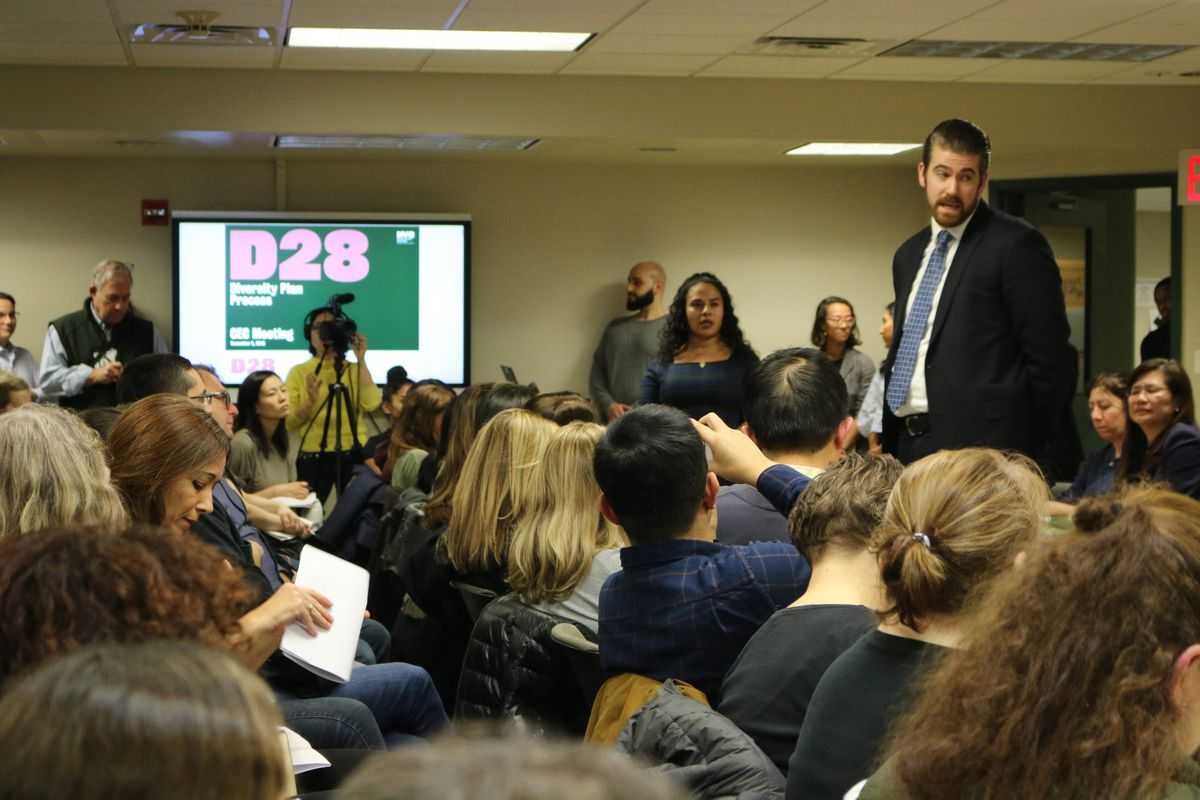 Education department officials took questions from parents regarding plans to integrate middle schools at a Community Education Council District 28 meeting in December 2019.