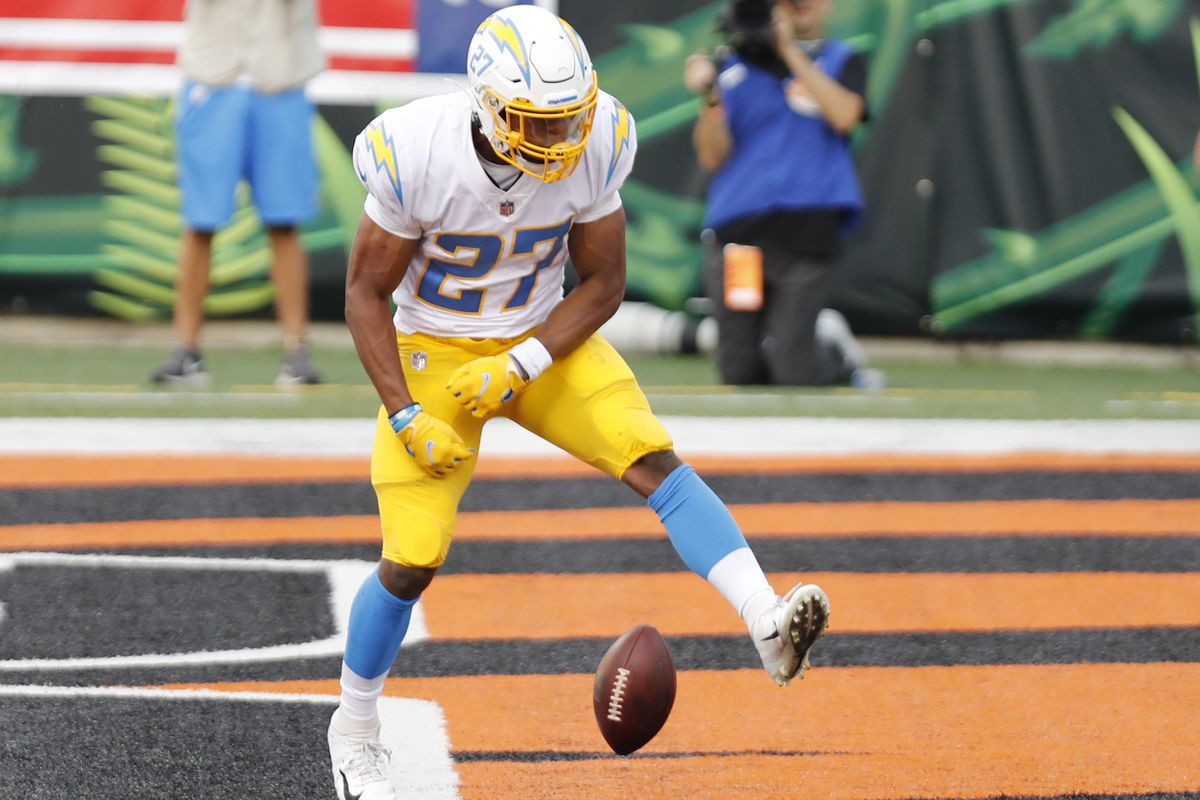Los Angeles Chargers running back Joshua Kelley (27) spikes the ball after scoring a touchdown against Cincinnati Bengals during the second half at Paul Brown Stadium. Mandatory Credit: David Kohl