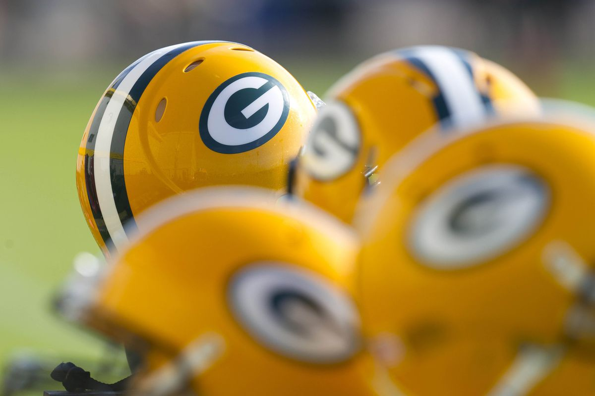 July 26, 2012; Green Bay, WI, USA; Green Bay Packers helmets during training camp practice at Ray Nitschke Field in Green Bay, WI. Mandatory Credit: Jeff Hanisch-US PRESSWIRE