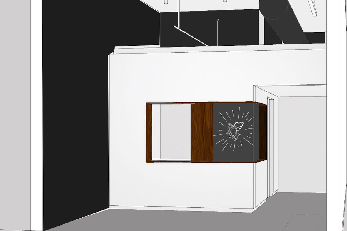 A walk-up window drawing surround by wood and a Cold Truth praying hands logo in a white room with one black accent wall.