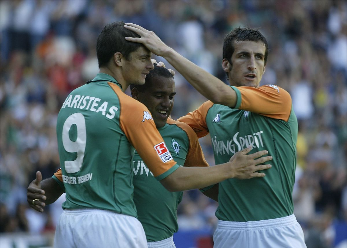 Angelos Charisteas of Bremen celebrates scoring the first goal with Ailton and Johan Micoud