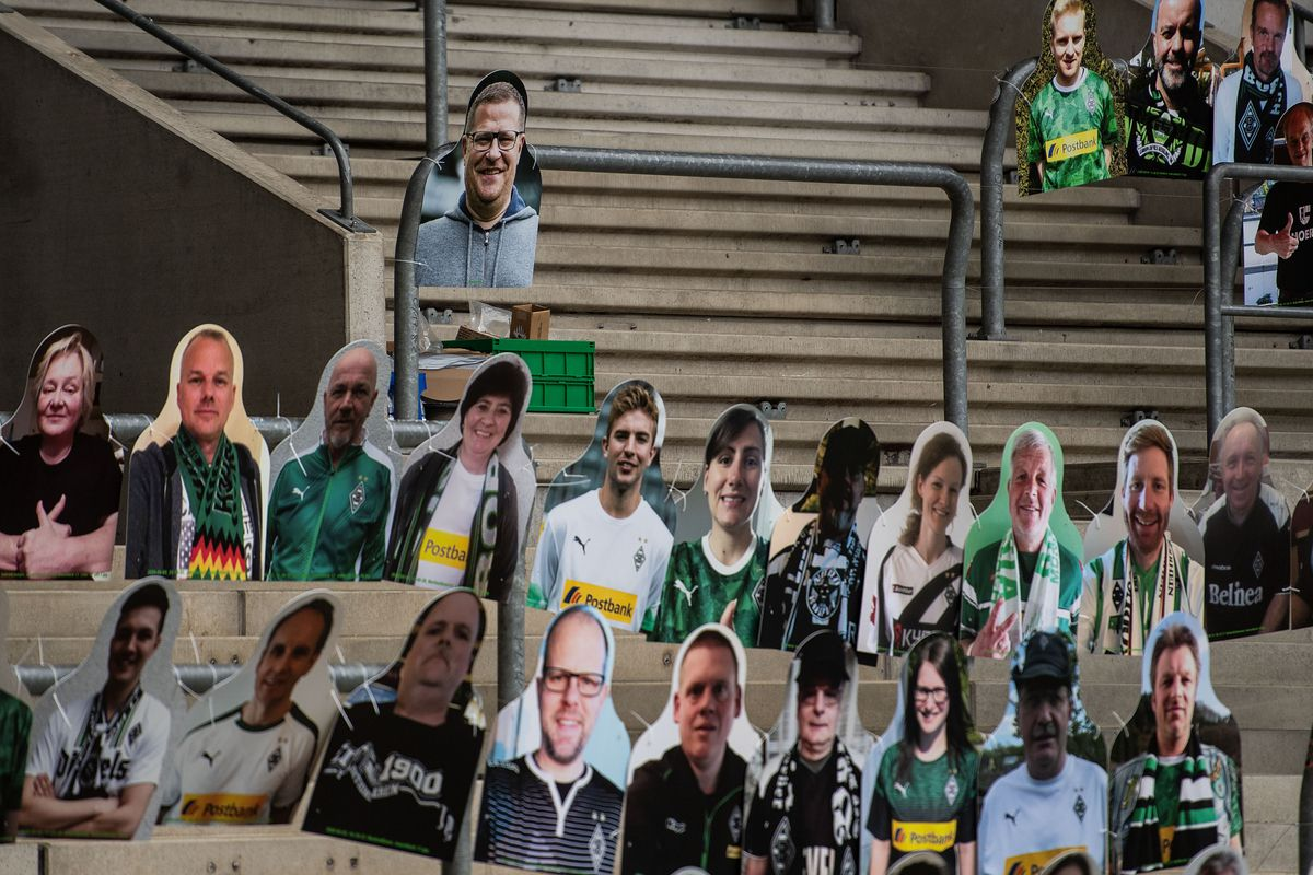 North Rhine-Westphalia, Mönchengladbach: Cardboard displays from fans of Borussia Mönchengladbach can be found in the north curve in Borussia-Park. The fans of Borussia Mönchengladbach want to contribute to a better atmosphere at possible ghost games in the German Football League. In order to spare the TV viewers and the professionals the view of the empty stadium seats, cardboard figures with the likeness of the supporters are set up.