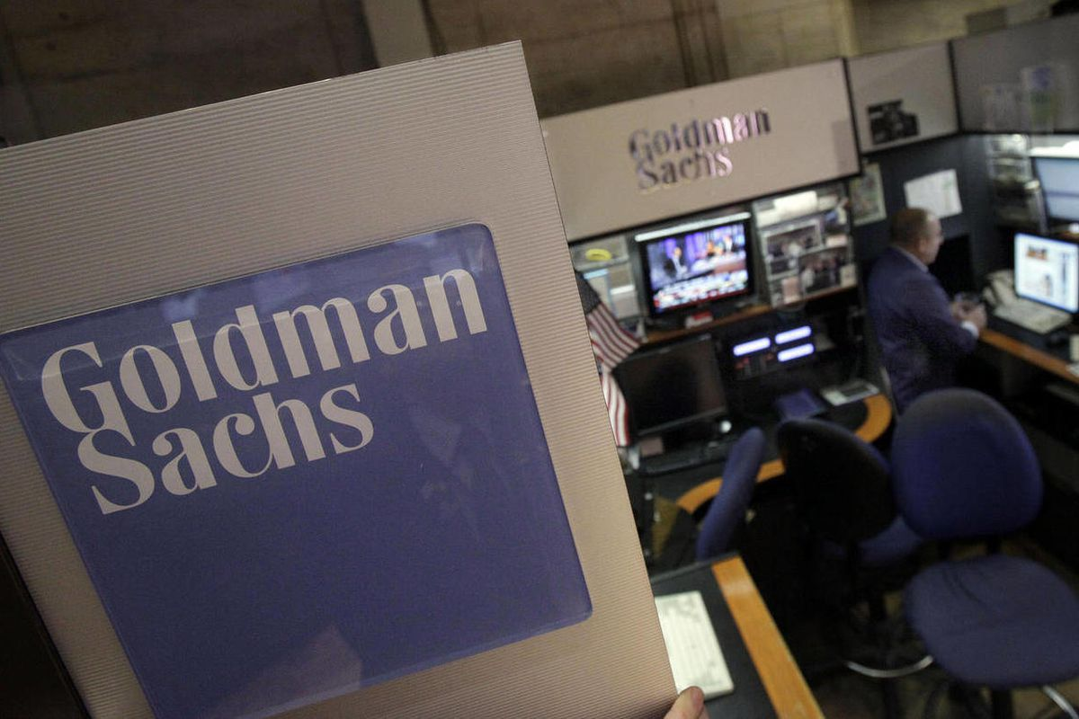FILE - In this March 15, 2012 photo, a trader works in the Goldman Sachs booth on the floor of the New York Stock Exchange. Goldman Sachs more than doubled its first-quarter profits and announced plans to raise its dividend Tuesday, March 17, 2012.  The s