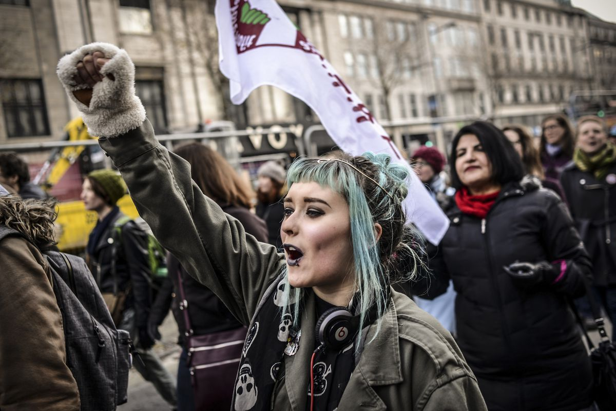 Women shouts slogans during a protest held in solidarity with the Washington DC Women's March in Dublin, Ireland on January 21, 2017.