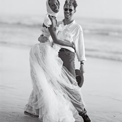 Iman and David Bowie. She's in a gown designed by Karl Lagerfeld for Chanel Haute Couture. He's the most conservative thing he's ever worn.