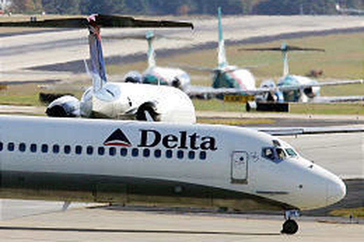 A Delta Air Lines jet waits on the tarmac to take off in Atlanta. Delta is seeking $325 million in concessions from pilots.