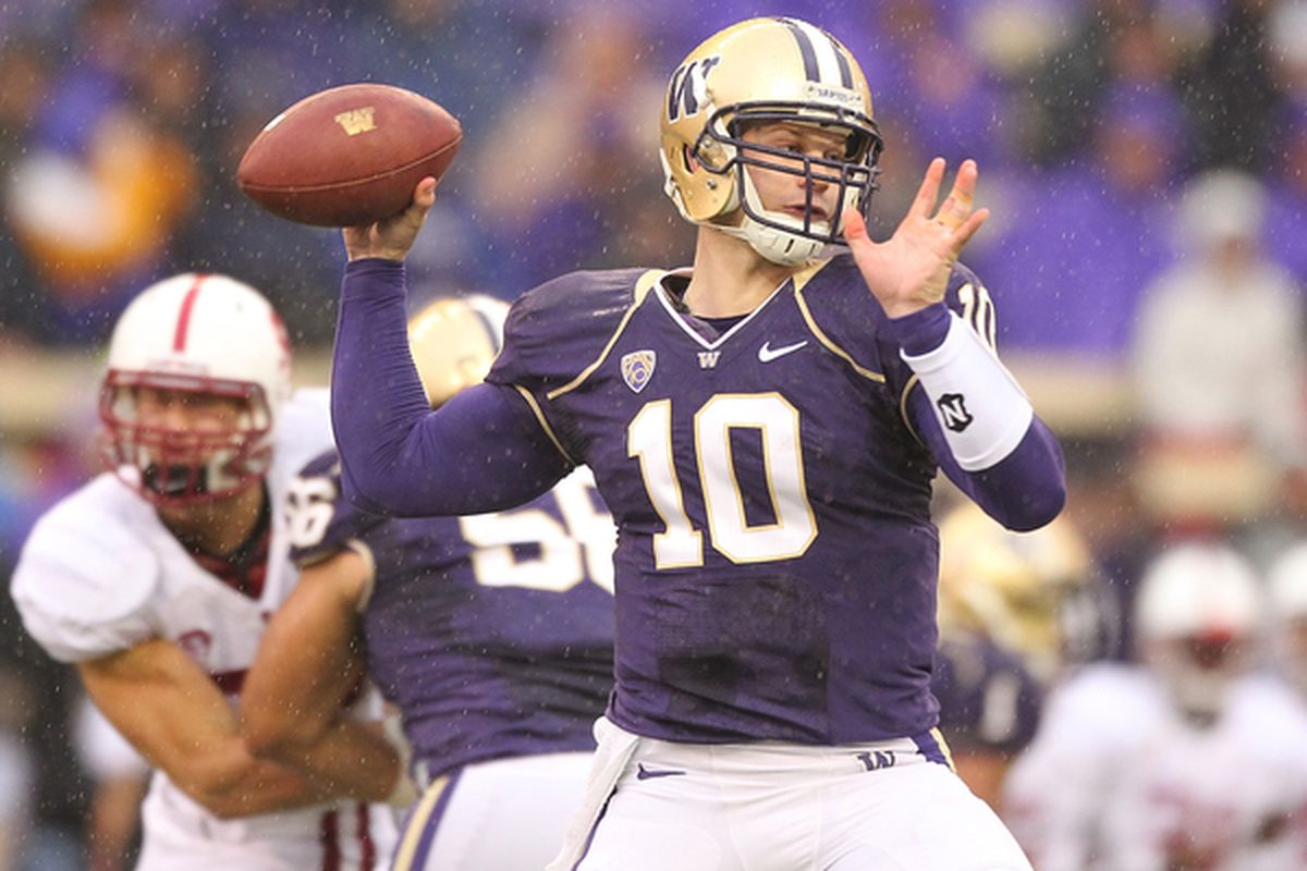 SEATTLE - OCTOBER 30:  Quarterback Jake Locker #10 of the Washington Huskies passes against the Stanford Cardinal on October 30 2010 at Husky Stadium in Seattle Washington. (Photo by Otto Greule Jr/Getty Images)
