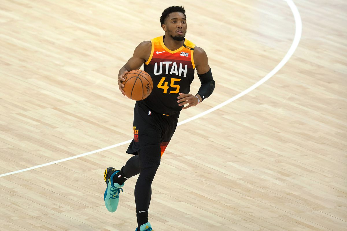 Utah Jazz guard Donovan Mitchell dribbles up the court against the Washington Wizards during the first half at Vivint Smart Home Arena.