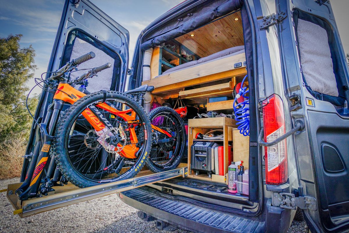 Diy camper van cost just 18k to build curbed the far out ride camper van prioritizes space for mountain biking and gear in a rear garage all photos courtesy of far out ride solutioingenieria Image collections