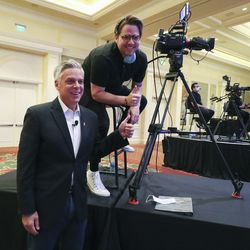 Former Gov. Jon Huntsman Jr. poses for a photo with photographer Joseph Nixon prior to a virtual forum featuring the Republican primary gubernatorial candidates at the Grand America Hotel in Salt Lake City on Thursday, May 7, 2020.