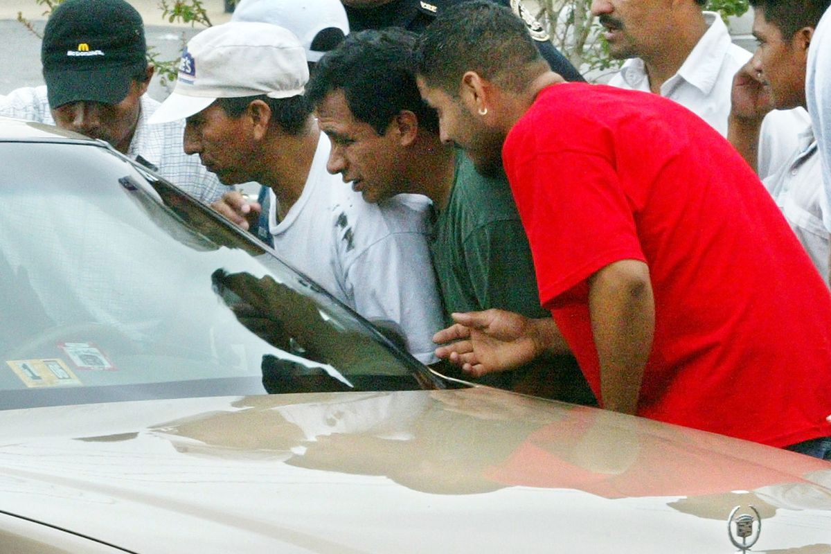 Day laborers gather around a car looking for work in Virginia.