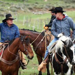 FILE - Rancher Sandy Johnson talks with U.S. Interior Secretary Ryan Zinke while on a horseback ride in the Bears Ears with local and state representatives on Tuesday, May 9, 2017.