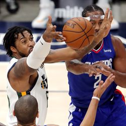Utah Jazz center Derrick Favors (15) battles for a rebound as the Utah Jazz and LA Clippers play in an NBA basketball game at Vivint Smart Home Arena in Salt Lake City on Friday, Jan. 1, 2021. Utah won 106-100.