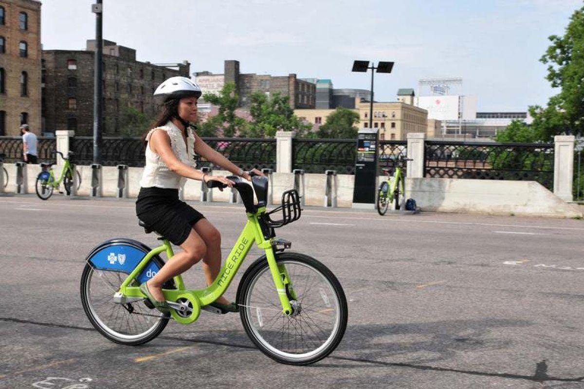 woman on bike share bike