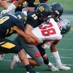 Mountain Ridge and Wasatch compete in a high school football game on Friday, Aug. 27, 2021, at Wasatch High School in Heber City.