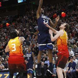 Minnesota Timberwolves' Andrew Wiggins (22) shoots as Utah Jazz's Ricky Rubio (3) and Joe Ingles (2) defend during the first half of an NBA basketball game Friday, March 2, 2018, in Salt Lake City. (AP Photo/Kim Raff)