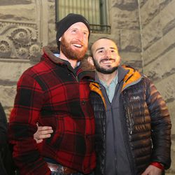 Derek Kitchen, left, and Moudi Sbeity, one of the gay couples that challenged Utah's constitutional definition of marriage, attend a rally celebrating a federal judge's decision legalizing same-sex marriage in Utah at the Salt Lake City-County Building on Monday, Dec. 23, 2013, in Salt Lake City.