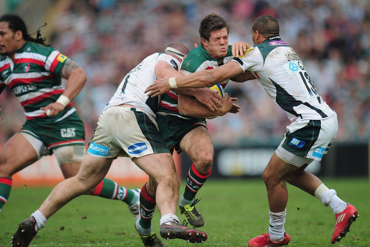 Anthony Allen of Leicester Tigers is tackled by Clarke Dermody and Jonathan Joseph (13) of London Irish during the AVIVA Premiership match between Leicester Tigers and London Irish at Welford Road on May 7, 2011 in Leicester, England.