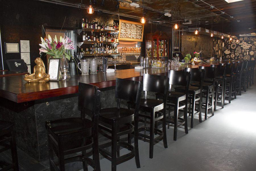 Bar interior with black walls and seats