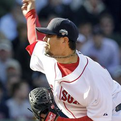 Boston Red Sox starting pitcher Josh Beckett fires a pitch to the Tampa Bay Rays during the eighth inning of a baseball game at Fenway Park in Boston, Friday, April 13, 2012.