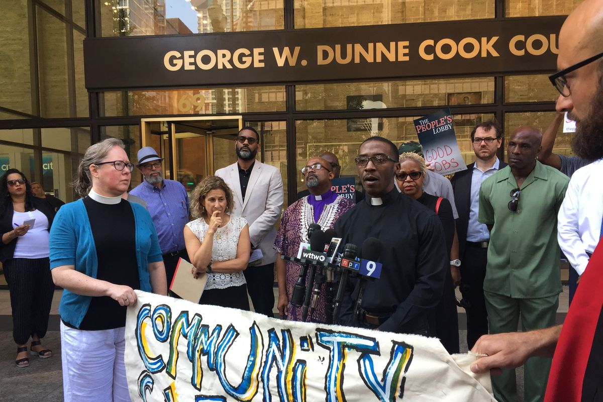 The Rev. Lawrence Marshall talks to reporters outside Cook County State's Attorney Kim Foxx's office at 69 W. Washington St. on Tuesday, July 30, 2019.