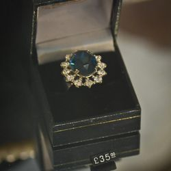 Yes, the Buckingham Palace gift shop sells a 35 GBP replica of Kate's engagement ring.