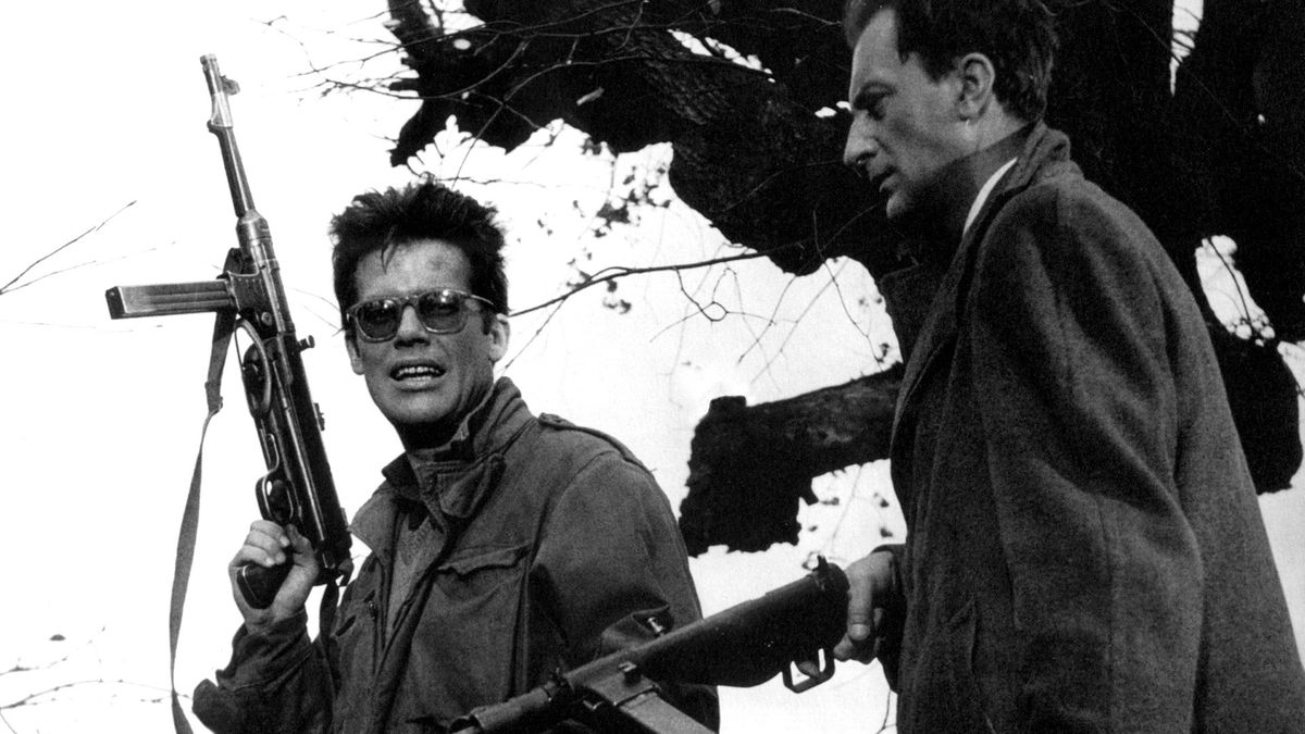 Two men hold guns in a scene from Ashes and Diamonds
